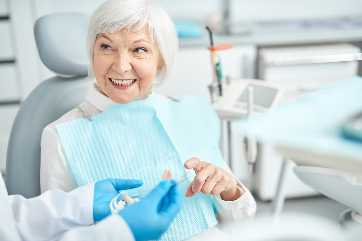 Senior lady asking questions about dental dentures