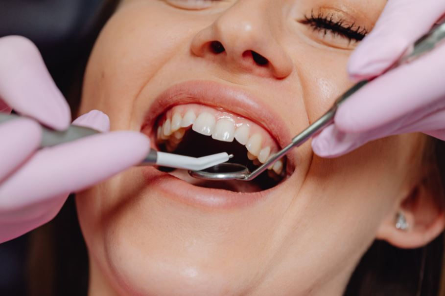 A woman getting her teeth checked